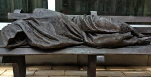 Homeless Jesus statue outside of Regis College