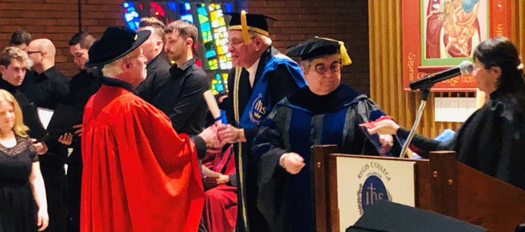 Rev. Dr. Francis X. Clooney, SJ, receives an honourary doctorate from Erik Oland, SJ, Chancellor of Regis College